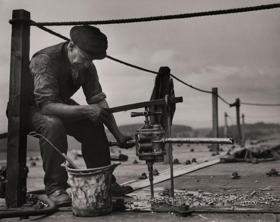 E.O. Hoppé: Ship building; drill & dye, Cunard-White Star Lines, John Brown's shipyards, Clydeside, Scotland, 1934 © 2017 Curatorial Assistance, Inc. / E.O. Hoppé Estate Collection